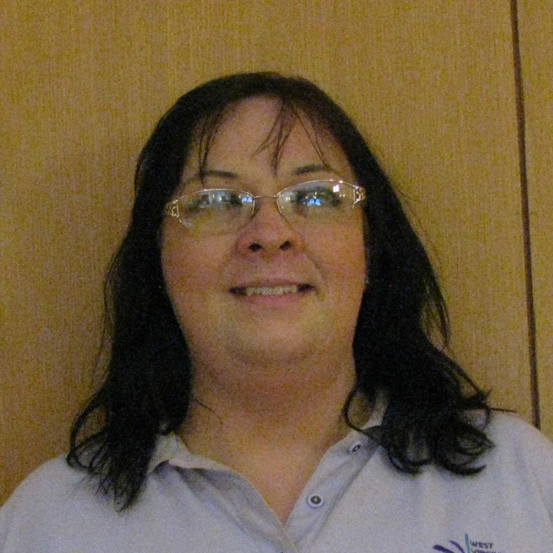 LISA HECHESKY, BOARD MEMBER AT-LARGE